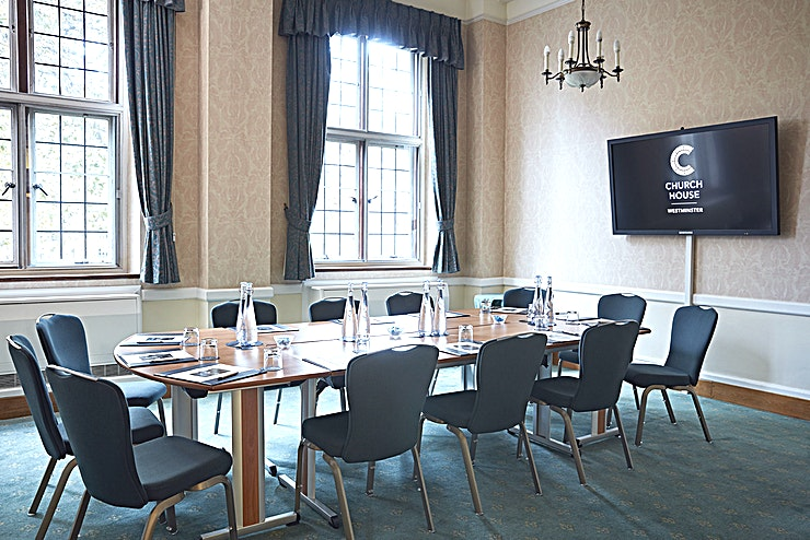 Charter Room **For more intimate company events, the Charter Room at Church House, Westminster is the perfect choice**  Often used for smaller meetings, the Charter Room is located on the first floor of Church House, Westminster. Just a short walk from Westminster tube station, this meeting room hire is ideal for the corporate commuter.  The Charter Room overlooks Dean's Yard and Westminster Abbey. Providing you and your Guests with an incredible view during your next team meeting.   With its elegant style, the Charter Room can be used for private meetings, intimate dinners and interview sessions. Alternatively, this event Space can be hired as an additional breakout space for larger conferences.  For a London meeting room hire in a historic venue, the Charter Room is an exemplary option.