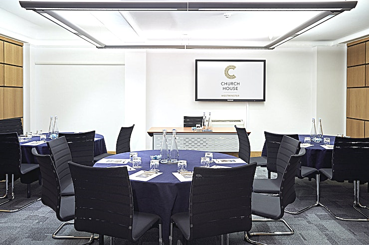 Ramsey Room **The Ramsey Room at the Church House in Westminster is a great option for London meeting room hire.   Located on the lower ground floor, our Ramsey Room is 40 square metres and is one of three small rooms purpose built for meetings, training and workshops. It has its own projector and screen and can be used individually or in conjunction with our Temple Room and Coggan Room.