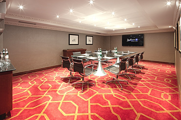 Private Room 18 **Between Hayes and Hounslow is a meeting room Space ideal for accommodating to the corporate commuter**  With its prime location next to Heathrow Airport, this Space is second to none when it comes to convenience.  The stunning surroundings of this hotel venue provide Guests with comfort and style.   Private Room 18 can host a stylish boardroom for up to 14 delegates. This Space is perfect for intimate team meetings and presentations.  For a venue bound to impress, the Radisson Blu Edwardian at Heathrow is an exemplary location for your next corporate event.