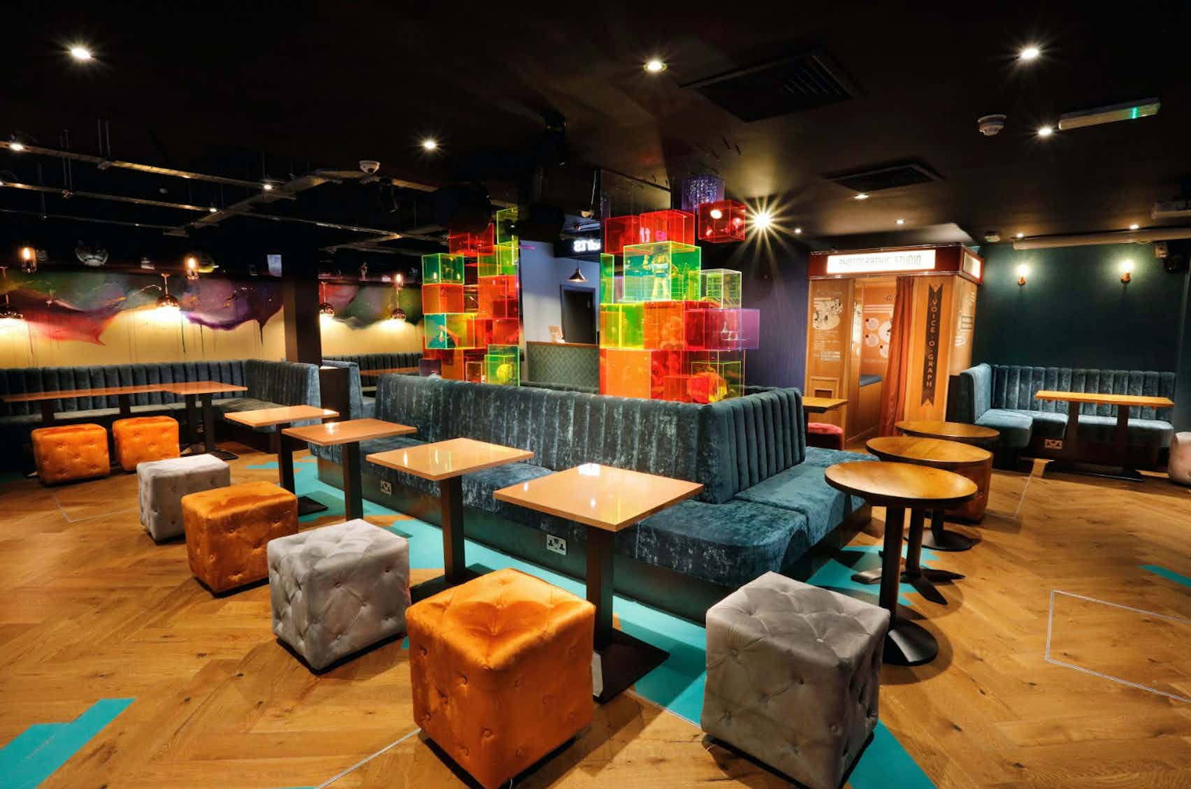 Book Bar area and private karaoke rooms at Lucky Voice