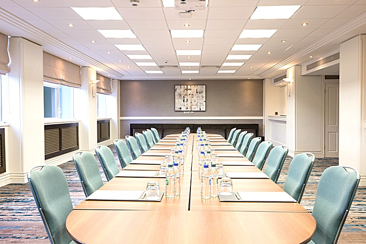 Meeting Room 12 **Meeting Room 12 is a small meeting room for hire in Dublin.**  Meeting Room 12 can accommodate 10 Guests sat board room style. The Hotel also has a further 18 dedicated meeting rooms all with natural daylight, which can accommodate up to 100 delegates and are ideal syndicate meeting rooms for events in our Fitzwilliam Hall.  A comfortable lobby area is also available - the ideal Space for event breaks or meeting and greeting colleagues. Take advantage of a wealth of contemporary business facilities in Clayton Hotel Burlington Road, including in-built A/V technology and complimentary WiFi.  A dedicated Business Centre Manager will be on call for any last minute requests and to ensure your event is a success.  Located 30 minutes from Dublin International Airport and a 15-minute walk from St Stephen's Green, our iconic Conference & Event Hotel caters for up to 1200 delegates with 20 supporting meeting rooms and 502 Guest bedrooms. For your convenience, car parking spaces are provided at the hotel (subject to availability).