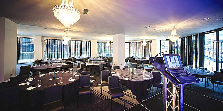Canalside **Canalside at Marco Pierre White at The Cube is a stunning dining room hire in Birmingham.**  Surrounded by floor to ceiling glass, the sliding doors open the perimeter of the room onto Birmingham'