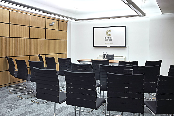 Coggan Room **Hire the Coggan Room at the Church House in Westminster for your meeting room hire in London.**  Church House in Westminster is one of the capital's true hidden gems, this top London venue hire is set within Dean's Yard and offers a peaceful and green setting along with stunning views of Westminster Abbey whilst being only a few minutes' walk from Big Ben, The Houses of Parliament and St James's Park.  Located on the lower ground floor, our Coggan Room is 38 square metres and can accommodate up to 25 people. It is one of three small rooms purpose-built for meetings, training and workshops. It has its own projector and screen and can be used individually or in conjunction with our Ramsey Room and Temple Room.