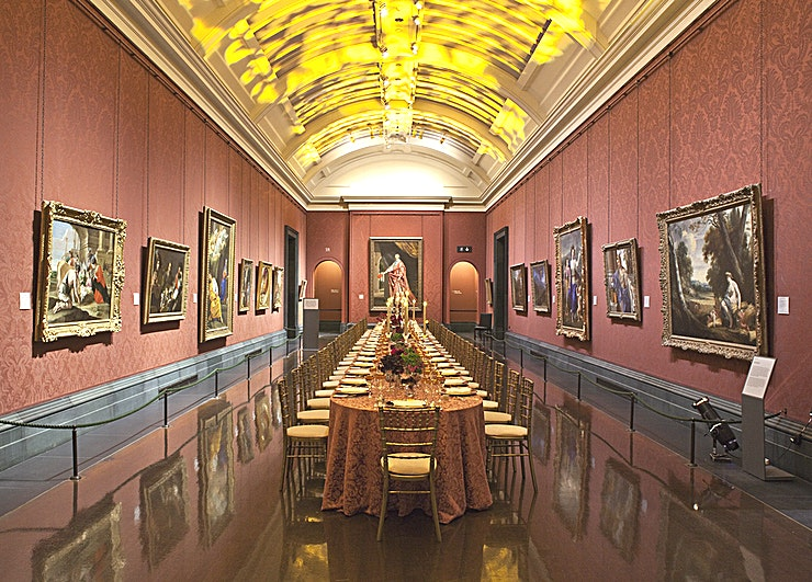The YSL Room **The YSL Room at The National Gallery is a stylish event Space for hire in St James's.**  The Yves Saint Laurent Room is an elegant gallery housing a stunning collection of work by Rubens, the most celebrated Flemish painter of Western art.   The opulent colouring of fabric on the walls contributes to the atmospheric setting for a stylish canapé reception for up to 100 Guests.