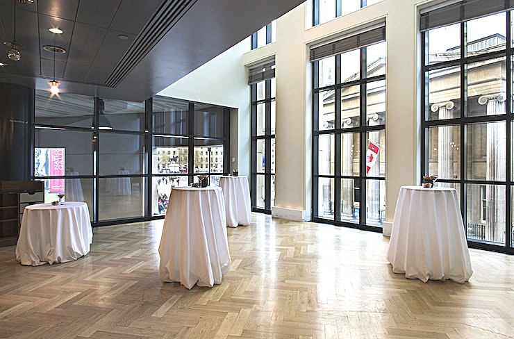 The National Dining Rooms **The National Dining Rooms at The National Gallery is a versatile event Space for hire in St James's.**  The National Dining Rooms are located within the modern Sainsbury Wing, designed by the award-winning architect Robert Venturi.   This Space has incredible views overlooking Trafalgar Square. Running along one wall is an exquisite mural by Paula Rego. This space can accommodate up to 300 Guests for a standing drinks reception.