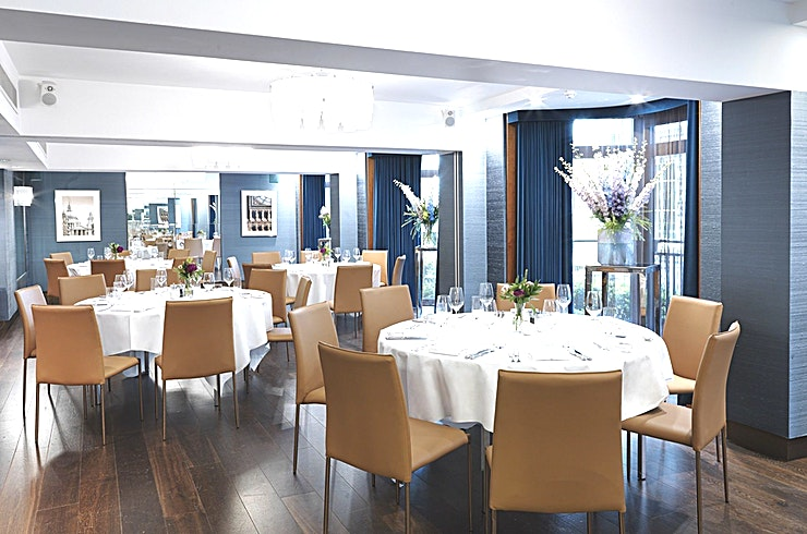 Hyde Park Suite **The Hyde Park Suite at The Athenaeum Hotel and Residences is a stylish meeting and creative Space in London.**  When it comes to hosting business meetings, conferences and corporate events, it is essential that all arrangements are made with precision.   The Athenaeum takes pride in attaining our top quality standards, whether you're planning a small board meeting or a launch event for 100 guests.   Located on the first floor, the Hyde Park Suite is our largest meeting space and is equipped with the latest technology including two built-in 70 inch TV's and a 360 degree acoustic sound system.  The Space is fully air-conditioned, has two points of entry and benefits from large floor to ceiling windows.  Birthday party? Wedding? Corporate entertaining? Whatever the occasion, private dining at The Athenaeum makes it a truly special celebration.   The Hyde Park Suite can accommodate up to 60 seated guests or 100 for a standing reception.  This stunning Space is perfect for you to pull out all the stops for a private dinner, cocktail party or an extra indulgent Afternoon Tea with friends and family.  The scrumptious menus and lavish canapes are created exclusively by Galvin at The Athenaeum, the hotel's restaurant from Michelin-starred chefs Chris and Jeff Galvin.