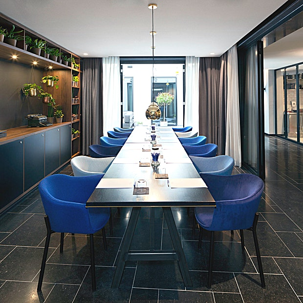Garden Room **INK Hotel Amsterdam - MGallery owes its name to the rich history of the building as former home of newspaper 'De Tijd' and features 149 Guest rooms including 10 suites.** 