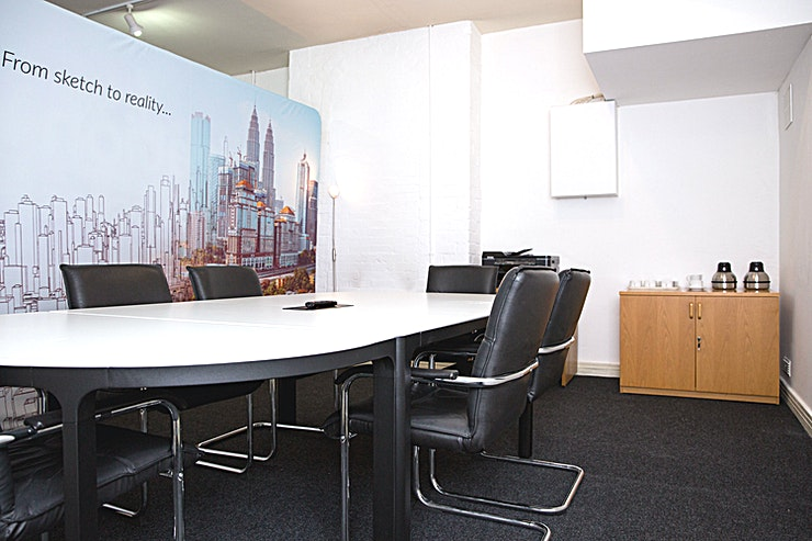 The Wharf Suite II **The Wharf Suite 1 is a versatile, state-of-the-art meeting Space for hire near Brindley Place in Birmingham.**  Located within walking distance to Brindley Place and canalside walking to Mailbox, Birmingham City Centre, New Street and Snowhill, this is an ideal location for the following:  • Meetings  • Training Events  • Team Away Days   • Special Events  The Space provides for a private environment offering a professional and welcoming room. Offering a room with a corporate feel.  The room can accommodate groups of up to 10 people.  The friendly team are on hand to support your event and meet your requirements.  - SMART TV WITH HDMI CABLE TO CONNECT TO LAPTOP  - CONFERENCING PHONE  - TEA AND COFFEE FACILITIES INCLUDED