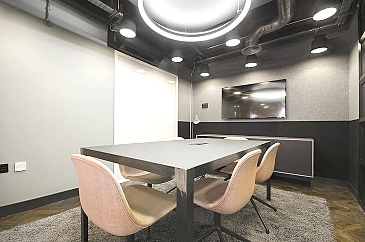 Court **Court at 60 Grays Inn Road is a state-of-the-art London meeting room for hire.**  This chic ground floor meeting room, with Space for up to 6 people, enjoys plenty of natural light, full-height wr