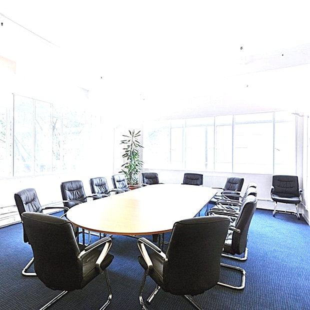 Meeting Room **Leroy House has a modern 12 person meeting room for hire in Islington.**  Bright, professional and neutrally-furnished, this 12-person meeting room features high-speed Wi-Fi and writeable flipchar