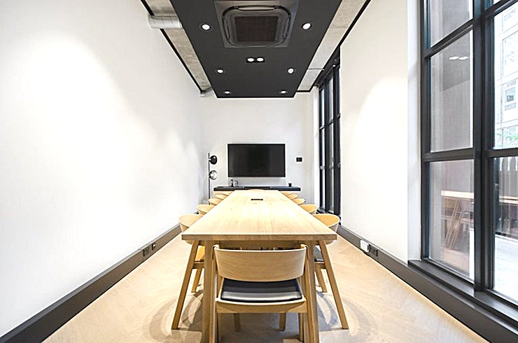 Picture **Picture at The Frames is a modern 12 person meeting room for hire in Shoreditch.**  Picture perfect furnishings, high tech connectivity, writeable presentation wall, super-fast Wi-Fi and a large LED screen; this 12 seat meeting room has everything you need.