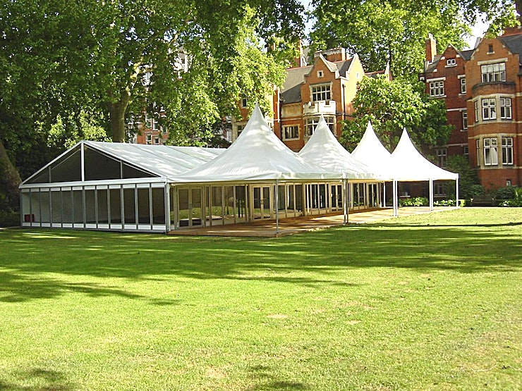 College Garden **Looking for an outdoor Space for hire in London? Look no further than the College Garden at Westminster Abbey.**  Make your next event memorable by hiring an exclusive location for a reception or dinner.  College Garden is a beautiful hidden gem in the heart of Westminster which offers magnificent views of the Abbey and the Victoria Tower; part of the Palace of Westminster.  Believed to be the longest continually cultivated garden in England, College Garden is an idyllic space for a reception, dinner, lunch or daytime business conference.  In June and July a stylish marquee with a decked porch area, and glass front and sides, is provided.   Outside of these months a marquee can be arranged to accommodate your event.