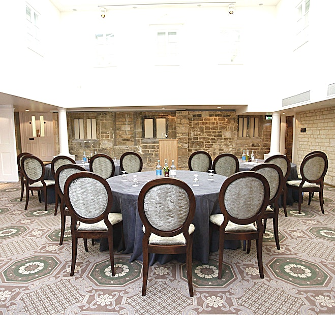 De La Bere Court  **De La Bere Court is a multi-functional event Space for hire in Cheltenham.**  Located on the ground floor of the Main House, this is Ellenborough Park's largest Space. The vaulted glass atrium mea