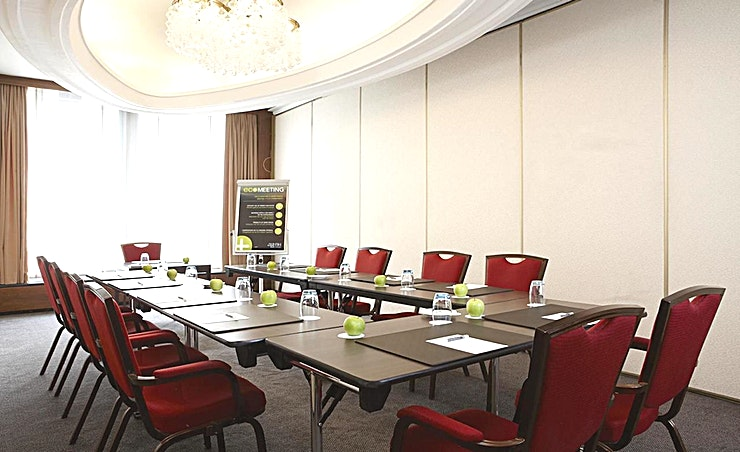 Cornelia Meeting room Cornelia is a modern and well-equipped business room where you can organize smaller-sized meetings. You can host up to 50 people. It's ideal for all types of small meetings, from a training to a presentation. The total surface is 30m2 and the ceiling height is 2.60m2. The room is equipped with free Wi-Fi, air conditioning, a projector, presentation case and a carpeted floor. Additionally, the room is wheelchair accessible and it has lots of daylight.   About NH Caransa: The hotel is located in the city center on one of the most famous squares of Amsterdam, Rembrandtplein, and close to restaurants, shops and sightseeing. It's the perfect venue to combine business with leisure. It has 66 spacious hotel rooms at her disposal and 4 modern meeting spaces. In the summer you can relax on our outdoor terrace. Thanks to its location, the hotel is easy accessible by public transport.  Feel Safe at NH: NH Hotel Group launched Feel Safe at NH in collaboration with the SGS. As part of this, 10 protocols have been established for the safety of guests, participants and employees. With this, we guarantee that you can organize your meeting or event in all health and safety. Our F&B services are also adapted to the current situation.  The loaded meeting room capacity is the standard one. In case that any COVID restriction or regulation applies to your request, the selected hotel will apply the corresponding restrictions during the quotation process. Based on destination, size and date of the event.