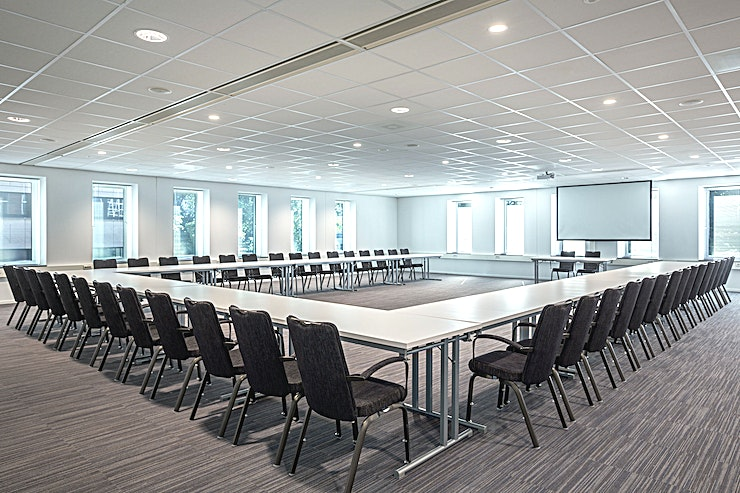 Rotterdam 2 The Rotterdam 2 is one of the biggest meeting rooms from the NH Den Haag. We can host up to 100 participants. These Rotterdam rooms can also be combined, and the area will be up to 511 square meters.