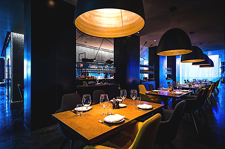 Kitchen **5&33 is a phenomenal restaurant with a sleek design and delicious Mediterranean dishes with an Italian twist.**   The restaurant has the amazing truffle dishes prepared in their open kitchen in th