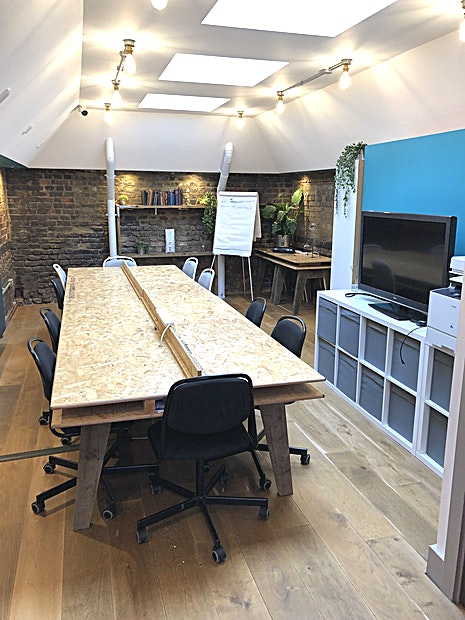 Meeting Room **The meeting room is located on the first floor above this new coffee shop.** 