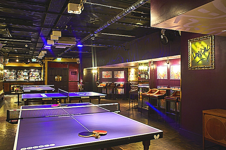 The Private - Jaques Room If you're on the look out for a quirky event Space your next private party in London, hire the private rooms at Bounce - the Home of Ping Pong  The luxurious and exclusive private 'Jaques Room' in Farringdon and 'Play Room' in Old Street, are ideal settings for groups of up to 120 Guests for you private party in London.   Each room boasts:  *3 bespoke designed Butterfly Ping Pong tables *a cocktail bar with a dedicated bar tender *ball collectors, no need to chase your balls *wireless presentation equipment with LCD screen and Funktion One sound system  *plug and play iPod docking station and DJ connection *UV Ping Pong - with iridescent artwork occupying the entire landscape *state of the art integrated karaoke system (Farringdon only) *personal photo pod for capturing the moment (Old Street only) *option to upgrade to a Premium Booking - let a Bounce Games Guru take care of everything * COVID safety measures in place  **Party around a Ping Pong table this Christmas!**  This Christmas Bounce invites you not sit around a table, but to play on it. There vibrant and luxurious private rooms will be transformed into a UV instagrammable wonderland; filled with delicious sharing bites, feel-good party tunes and even bottomless drink packages.  For more information, please feel free to message us on HeadBox!