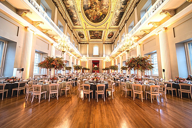 Venue hire **Hire one of the most iconic venues in London with the Banqueting House.**   Specially created for entertaining in 1622, the Banqueting House is a dazzling historic venue in the heart of London. Designed by Inigo Jones for James I in the Palladian style, it is one of England's earliest Classical buildings. Your guests will walk in the footsteps of royalty as they enjoy their event under the magnificent ceiling painted by Sir Peter Paul Rubens.   With its glittering chandeliers and soaring pillars, it is an ideal setting for dinners, receptions and awards ceremonies. Underneath the Main Hall is the atmospheric vaulted Undercroft suitable for more intimate dinners, parties and receptions.  Able to seat 380 comfortably to dine, this hall was originally built in 1622 to be an entertaining and dining space for King James I. Seating can be arranged into intimate round tables of up to 10, or arranged into up to 3 spectacular long tables spanning the length of the hall. The original ceiling paintings commissioned by King Charles I and were painted by Peter Paul Rubens.  Contrasting to the Main Hall above, the Undercroft of Banqueting house was designed as a drinking den for James I and his friends and was used for riotous parties and gambling. Its vaulted space provides a perfect ambience for pre-dinner drinks, atmospheric after party and its neutral colours lend it well to branding or colour washes. The undercroft can be hired either by itself or in addition to the main hall above. Banqueting House is closed on Thursday allowing for all day builds and setups for large events, alternatively, it can be used for luxury conferencing or daytime events. The Undercroft can accommodate 250 for a standing reception or after party with dancing.