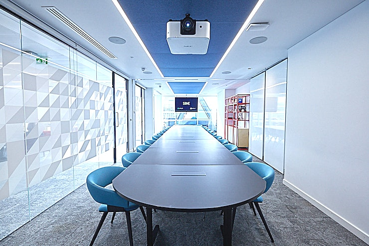 MR6.1 & MR6.2 **Hire MR6.1 & MR6.2 at 58VE for an ideal private meeting venue in London.**  This is the largest meeting room available on the 6th floor offers a flexible working space which can comfortably seat up to 26 people boardroom or up to 50 people theatre style.   The room is flooded with natural daylight with views of the Shard and Tate Modern. It features writable wall panels and includes access to our communal lounge and balcony.   Ideal for board meetings, larger training sessions, workshops and presentations the room is fully supported by plug and play AV technology and room temperature control.