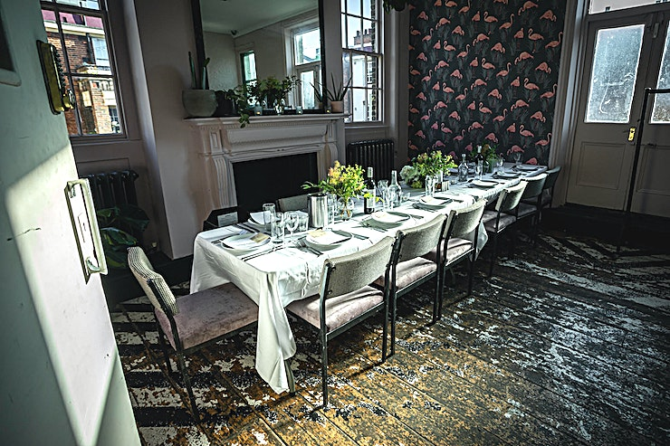 The Sanctuary **The Sanctuary at Upper House is a unique and inspiring private dining venue for hire in Islington.**  It's an impressive three-storey Victorian townhouse on Upper Street. The venue has a long history, and has been a purveyor of fine food, drinks and entertainment since 1856.  Upper House is one of the most stylish London party venues in North London and the Sanctuary will definitely impress all your guests.  Today, its current owners, armed with a drill and a creative mind, have transformed its interiors into a magical place where there is only room to eat, drink and party!  Whether you're looking for somewhere to reserve a few tables for drinks, cocktails at the bar, a banquet table for private dining or an exclusive room for a birthday party or a wedding reception, Upper House makes the perfect venue for any size soiree.  The Sanctuary is our most intimate private room situated on the middle floor of the House, with space for 20 dining or 30 standing. The space boasts its own bespoke bar, as well as its unique and colorful wallpaper and stunning original features.  --PLEASE NOTE THIS SPACE FEE IS BASED ON A MINIMUM SPEND—