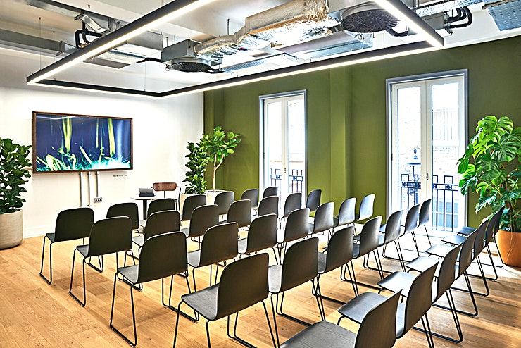 """The Loft **This bright and spacious space provides a unique and inspiring setting for any type of small conference or panel.**   Designed with clean, modern Scandinavian lines and subtle lounge-style furniture to keep the entire space feeling cohesive and bright.   The Loft is equipped with high-end amenities including a 65"""" 4K digital screen, Hi-Speed WIFI as well as a coffee machine, tea, still and sparkling water."""