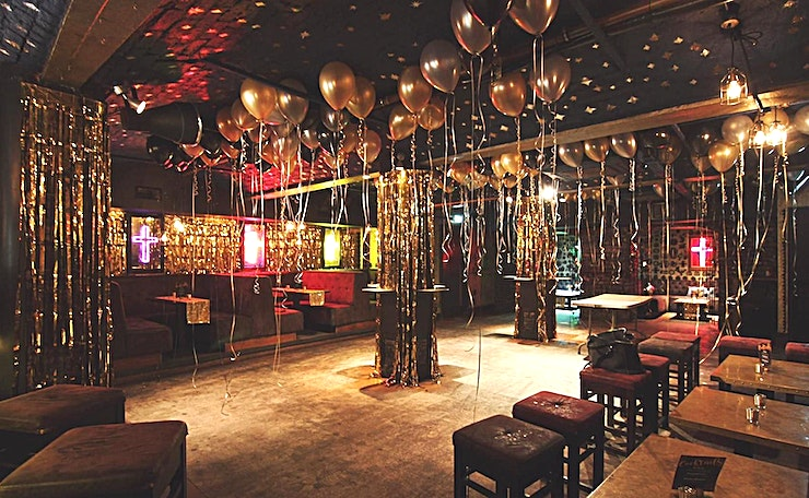 Club *Subterranean Day of the Dead inspired tequila bar*   Candle lit with accents of gold, with the famous neon crosses illuminating the way. Sit in caged booths or stand at the gilded bar complete with hanging bulbs. Cosy and romantic whilst cool and unassuming.