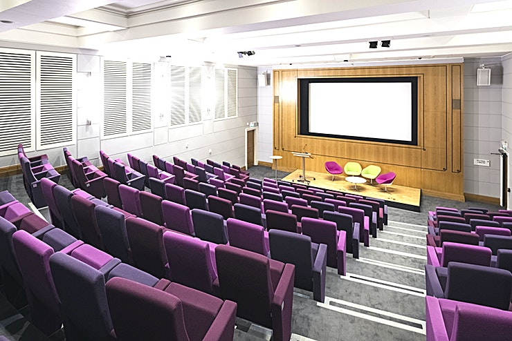 Henry Wellcome Auditorium **The Henry Wellcome Auditorium is a tiered theatre Space for 154 people. It has a raised stage area for nine speakers**