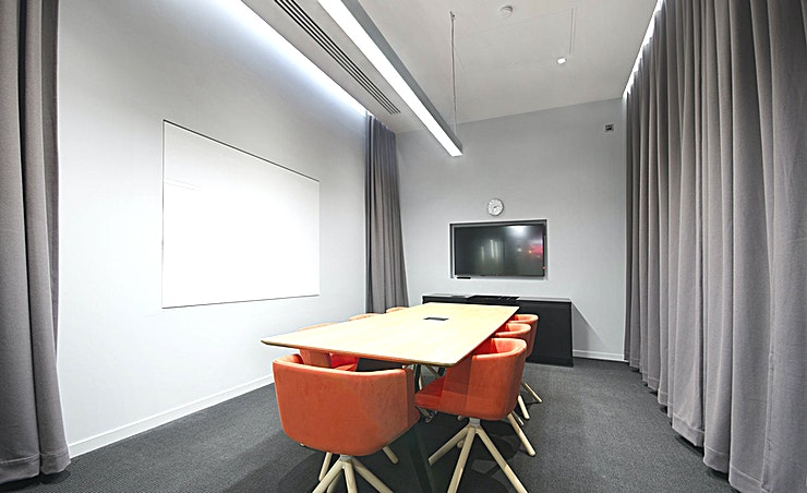 """Stock **Want a creative meeting room to hire in Vauxhall? Welcome to the Workspace branch at Vox Studios - perfect for those productive days out of the office.**   One of our two 8 person meeting rooms at Vox Studios, Stock features minimalist, sleek furnishing and is located just off of the central communal area - perfect for meeting and entertaining clients.  The room features a 55"""""""" LED screen, high-speed Wi-Fi and a writable wall, and the on-site cafe is on hand to provide refreshments as needed."""