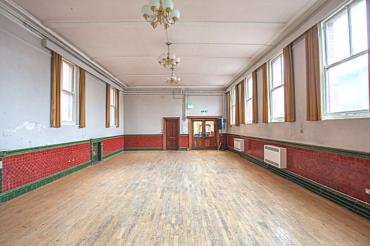 The Society Room **The Society Room is an attractive multi-use room retaining original Edwardian features including patterned ceramic tiling and original fireplaces.**